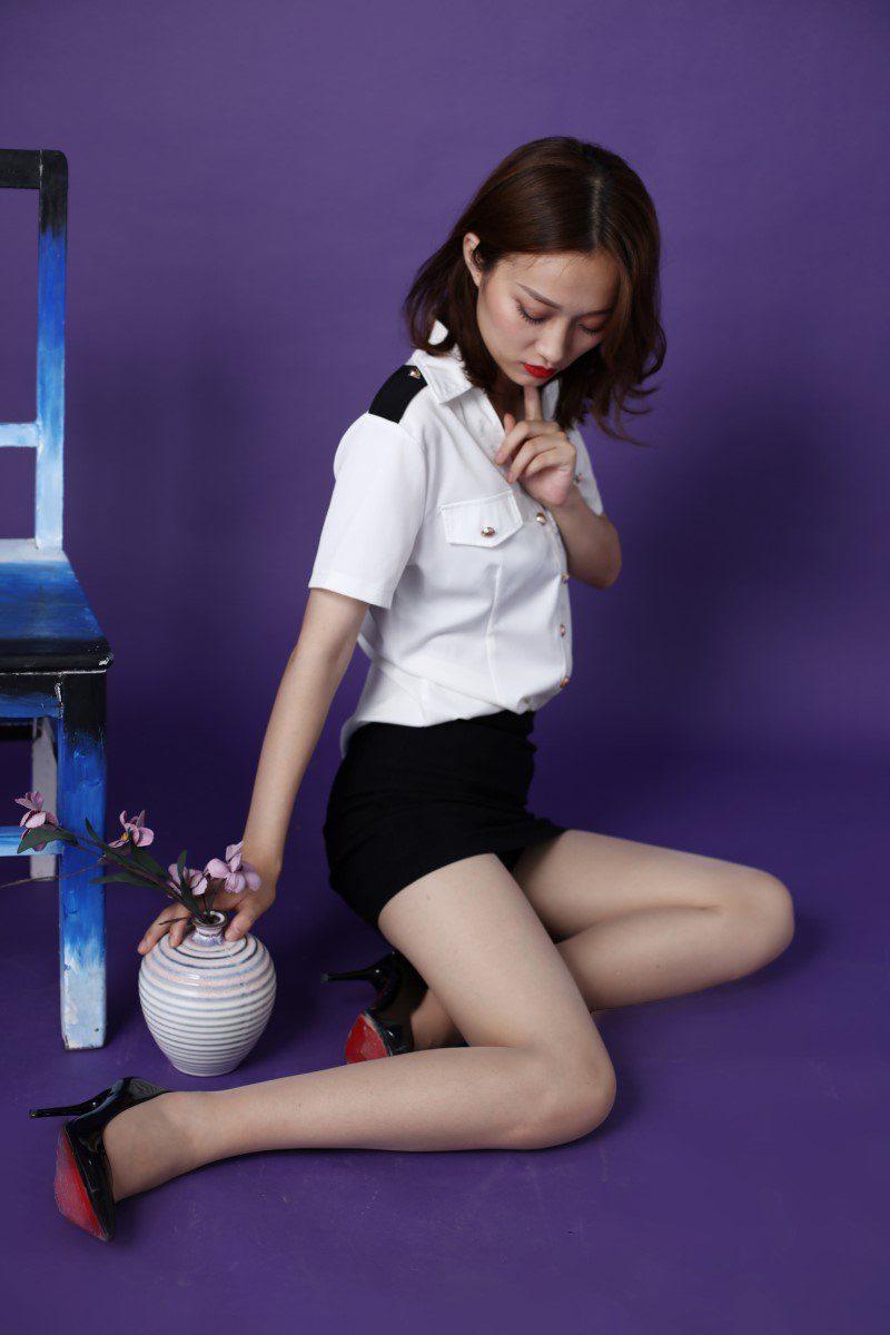 [奈丝写真]NO.144 莹莹-紫色布景下的cos女警装[41P/504M]